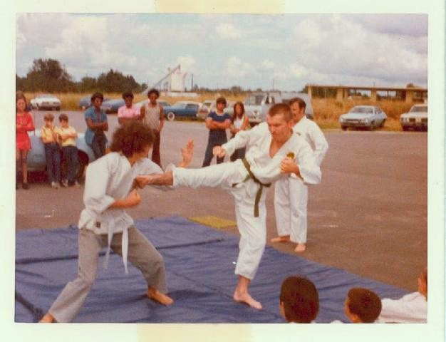 Cox Sensei (then green belt) kicking at Palmer Sensei's Titusville Dojo - Oct 74