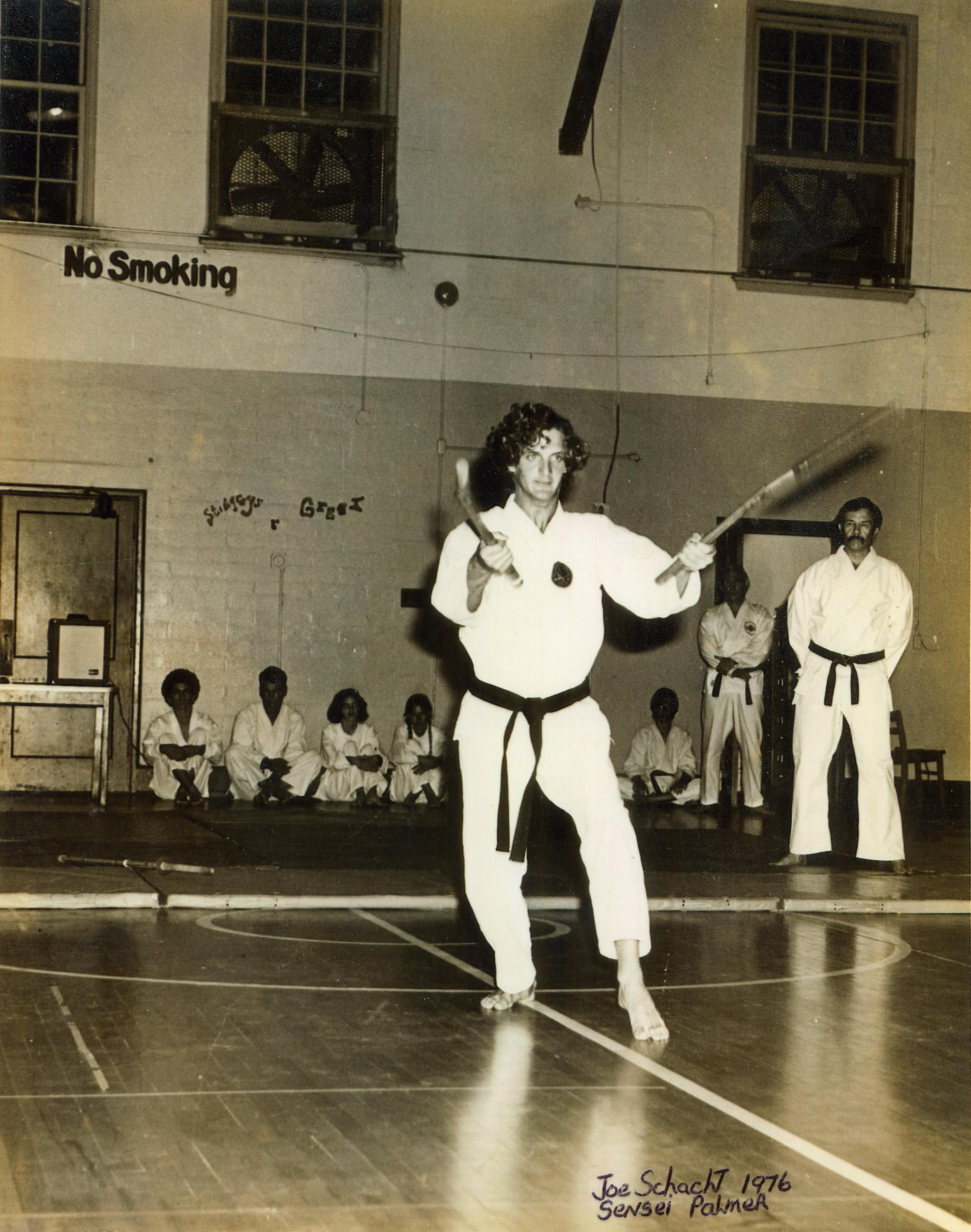 Sensei Joe Schacht demonstrating nunchaku's under the watchful eye of Renshi Sam Palmer